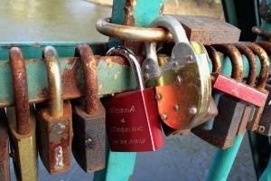 Close-up of love padlocks on bridge